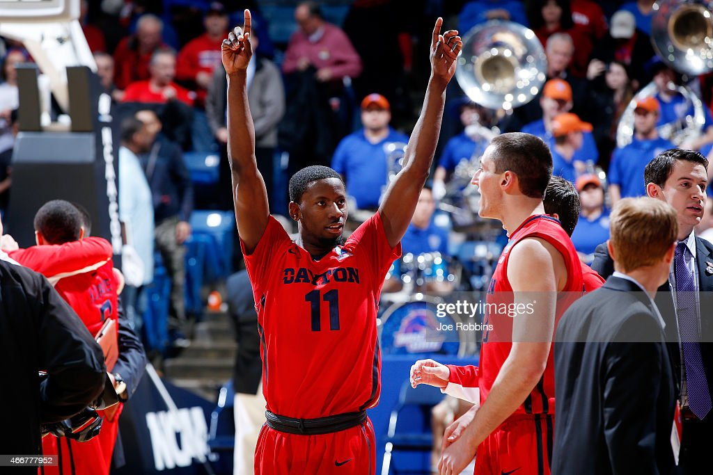 Scoochie Smith of the Dayton Flyers celebrates after defeating the Boise State Broncos 5655 in the first round of the 2015 NCAA Men's Basketball...