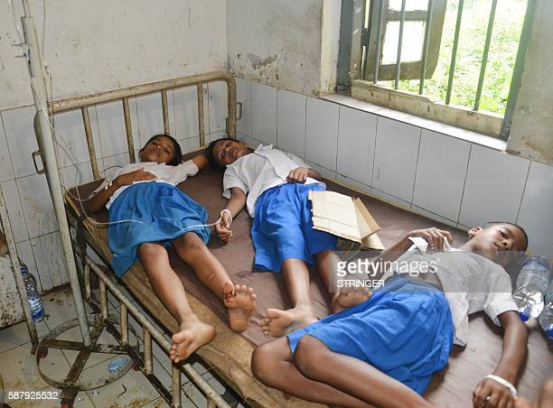 Scoolgirls lie on a hospital bed as around 300 school children were hospitalized after they received deworming medication at Kadamtala PHC in...