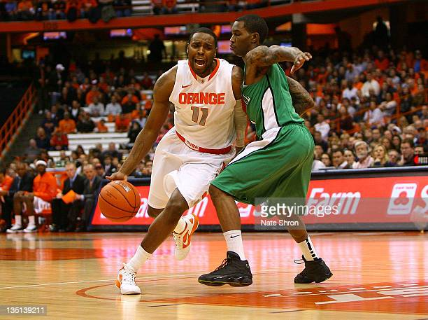 Scoop Jardine of the Syracuse Orange drives to the basket against Damier Pitts of the Marshall Thundering Herd during the game at the Carrier Dome on...
