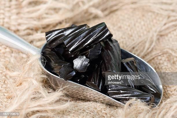 Scoop of Black Liquorice Candy on Burlap
