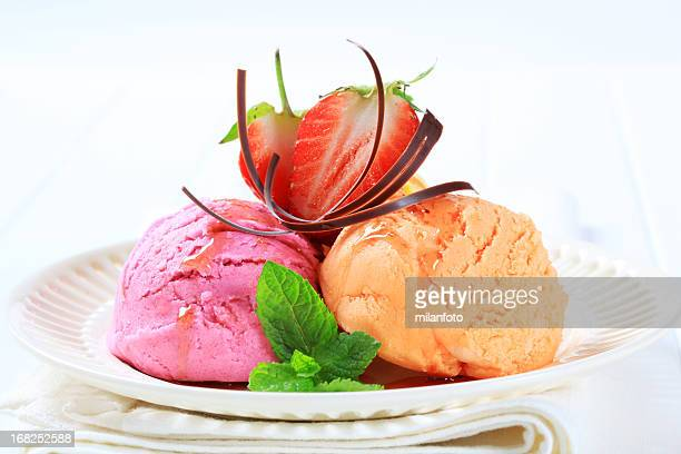 Scoops of mix fruit icecream on a plate