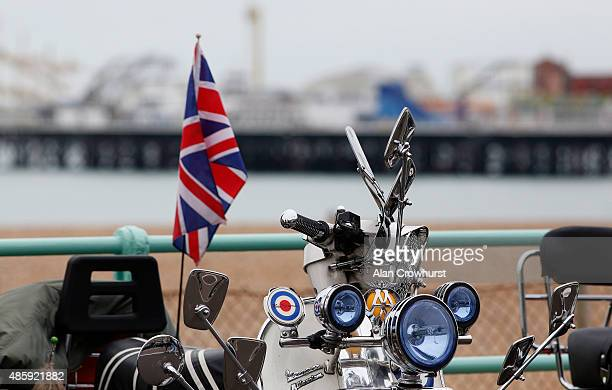 A scooter against a backdrop of Brighton Pier during the Brighton Mod Weekender where mods and their scooters gather on the annual bank holiday...