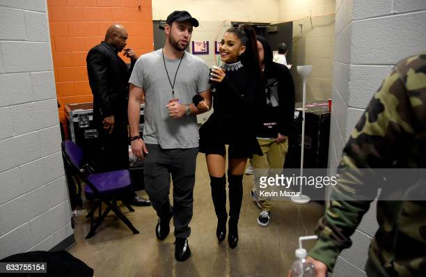 Scooter Braun and Ariana Grande walk backstage during the 'Dangerous Woman' Tour Opener at Talking Stick Resort Arena on February 3 2017 in Phoenix...