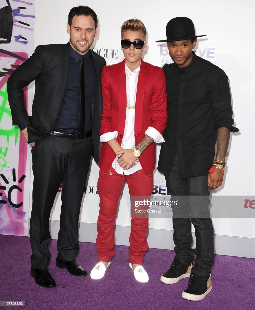 Scooter Braun, Justin Bieber and Usher arrives at the 'Justin Bieber's Believe' World Premiere at Regal Cinemas L.A. Live on December 18, 2013 in Los Angeles, California.