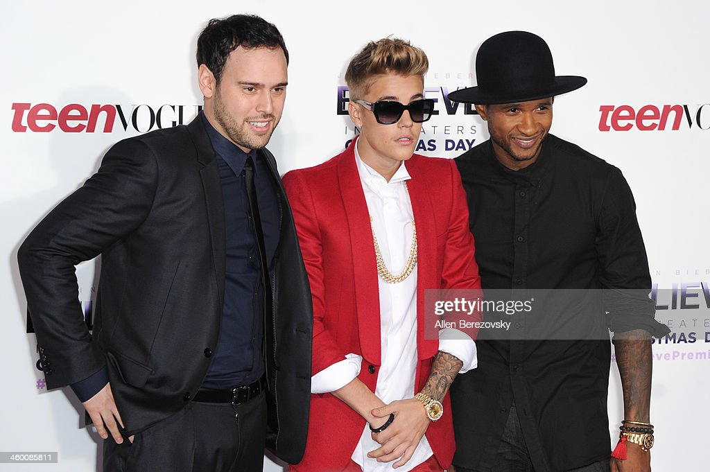 Scooter Braun Justin Bieber and Usher attend the premiere of Open Road Films' 'Justin Bieber's Believe' at Regal Cinemas LA Live on December 18 2013...