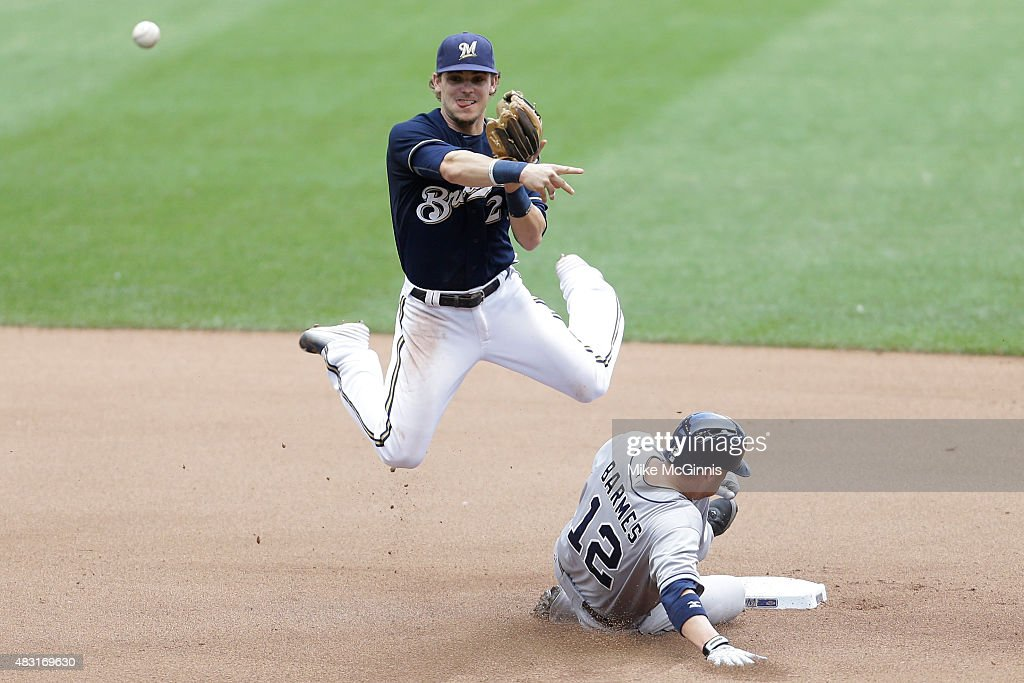 Scooter Gennett #2 of t3he Milwaukee Brewers attempts a double play in the seventh inning sa Clint Barmes #12 of the San Diego Padres slides into second base in the seventh inning at Miller Park on August 06, 2015 in Milwaukee, Wisconsin.