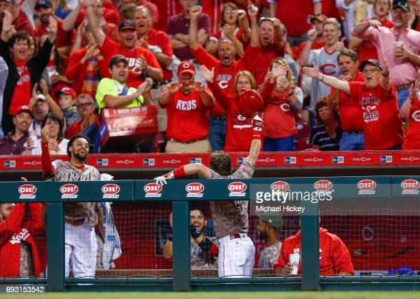 Scooter Gennett of the Cincinnati Reds acknowledges the crowd after hitting his third home run in the eighth inning against the St Louis Cardinals at...