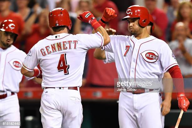 Scooter Gennett of the Cincinnati Reds celebrates with Eugenio Suarez of the Cincinnati Reds after hitting a threerun home run in the ninth inning...