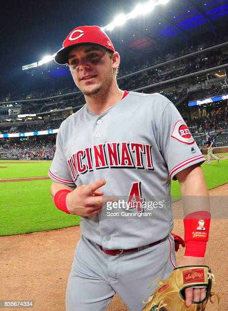 Scooter Gennett of the Cincinnati Reds heads off the field after the game against the Atlanta Braves at SunTrust Park on August 19 2017 in Atlanta...