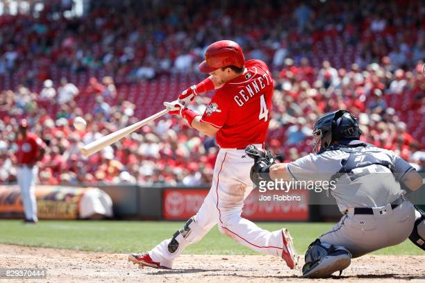 Scooter Gennett of the Cincinnati Reds hits a grand slam home run in the seventh inning of a game against the San Diego Padres at Great American Ball...