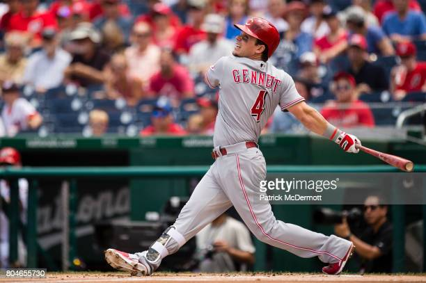 Scooter Gennett of the Cincinnati Reds hits a RBI single scoring Billy Hamilton in the first inning during a game against the Washington Nationals at...