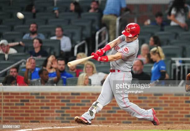 Scooter Gennett of the Cincinnati Reds hits an eighth inning grand skam against the Atlanta Braves at SunTrust Park on August 19 2017 in Atlanta...