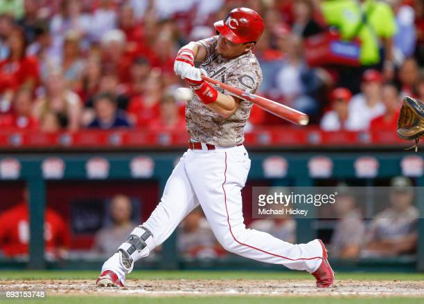 Scooter Gennett of the Cincinnati Reds hits his third home run of the game in the eighth inning against the St Louis Cardinals at Great American Ball...