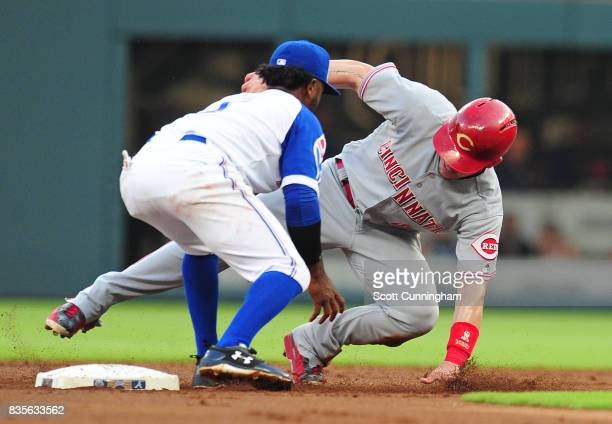 Scooter Gennett of the Cincinnati Reds is tagged out on a second inning steal attempt by Ozzie Albies of the Atlanta Braves at SunTrust Park on...