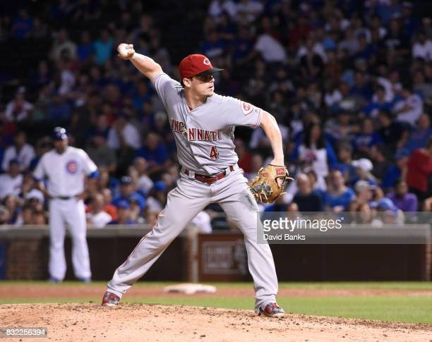 Scooter Gennett of the Cincinnati Reds pitches against the Chicago Cubs during the eighth inning on August 14 2017 at Wrigley Field in Chicago...