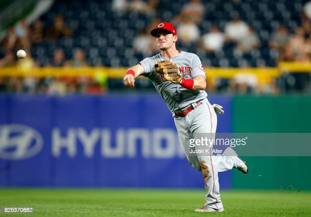 Scooter Gennett of the Cincinnati Reds record a put out against the Pittsburgh Pirates at PNC Park on August 1 2017 in Pittsburgh Pennsylvania