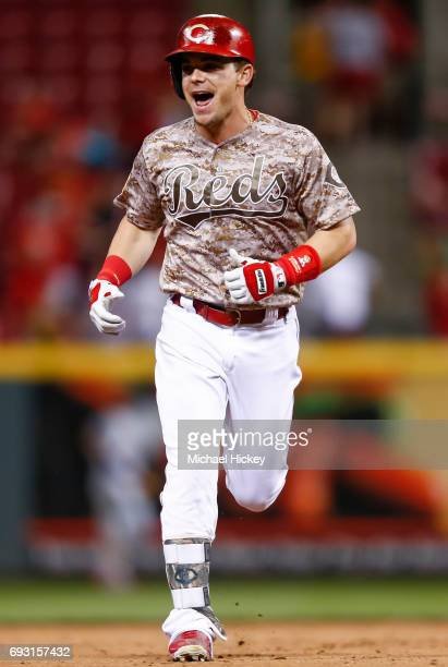 Scooter Gennett of the Cincinnati Reds runs the bases after hitting his fourth home run of the game in the eighth inning against the St Louis...
