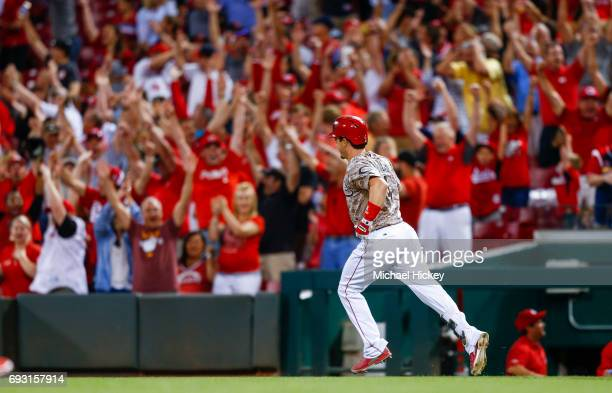 Scooter Gennett of the Cincinnati Reds runs the bases as the crowd cheers after hitting his fourth in the eighth inning against the St Louis...