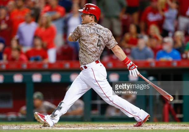 Scooter Gennett of the Cincinnati Reds watches his fourth home run against the St Louis Cardinals at Great American Ball Park on June 6 2017 in...
