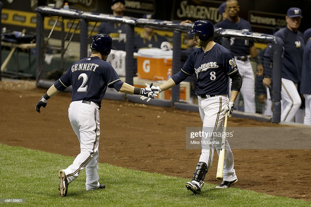 <a gi-track='captionPersonalityLinkClicked' href=/galleries/search?phrase=Scooter+Gennett&family=editorial&specificpeople=5502894 ng-click='$event.stopPropagation()'>Scooter Gennett</a> #2 of the Milwaukee Brewers celebrates with Ryan Braun after hitting a solo home run in the bottom of the fifth inning against the San Diego Padres at Miller Park on April 22, 2014 in Milwaukee, Wisconsin.