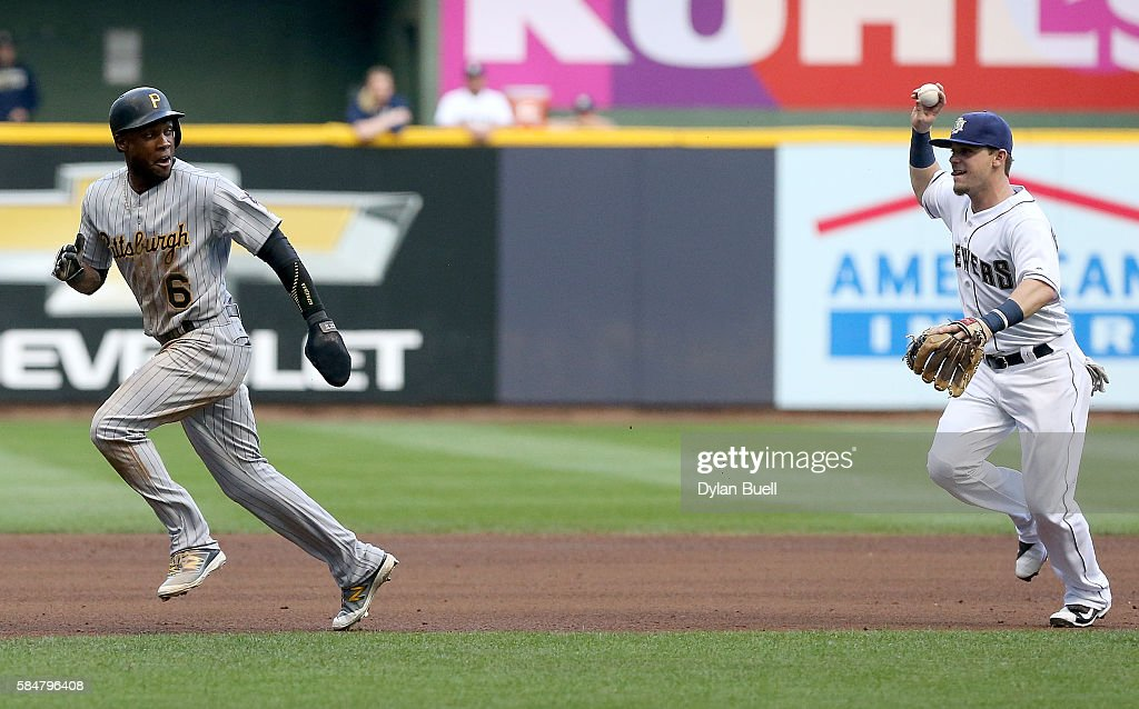 Scooter Gennett of the Milwaukee Brewers chases after Starling Marte of the Pittsburgh Pirates during a run down in the fourth inning at Miller Park...