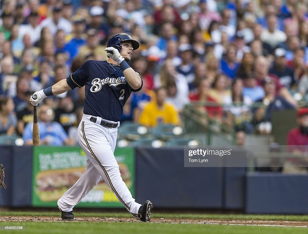 <a gi-track='captionPersonalityLinkClicked' href=/galleries/search?phrase=Scooter+Gennett&family=editorial&specificpeople=5502894 ng-click='$event.stopPropagation()'>Scooter Gennett</a> #2 of the Milwaukee Brewers follows through with a solo home run off of Edinson Volquez #36 of the Pittsburg Pirates at Miller Park on August 23, 2014 in Milwaukee, Wisconsin.