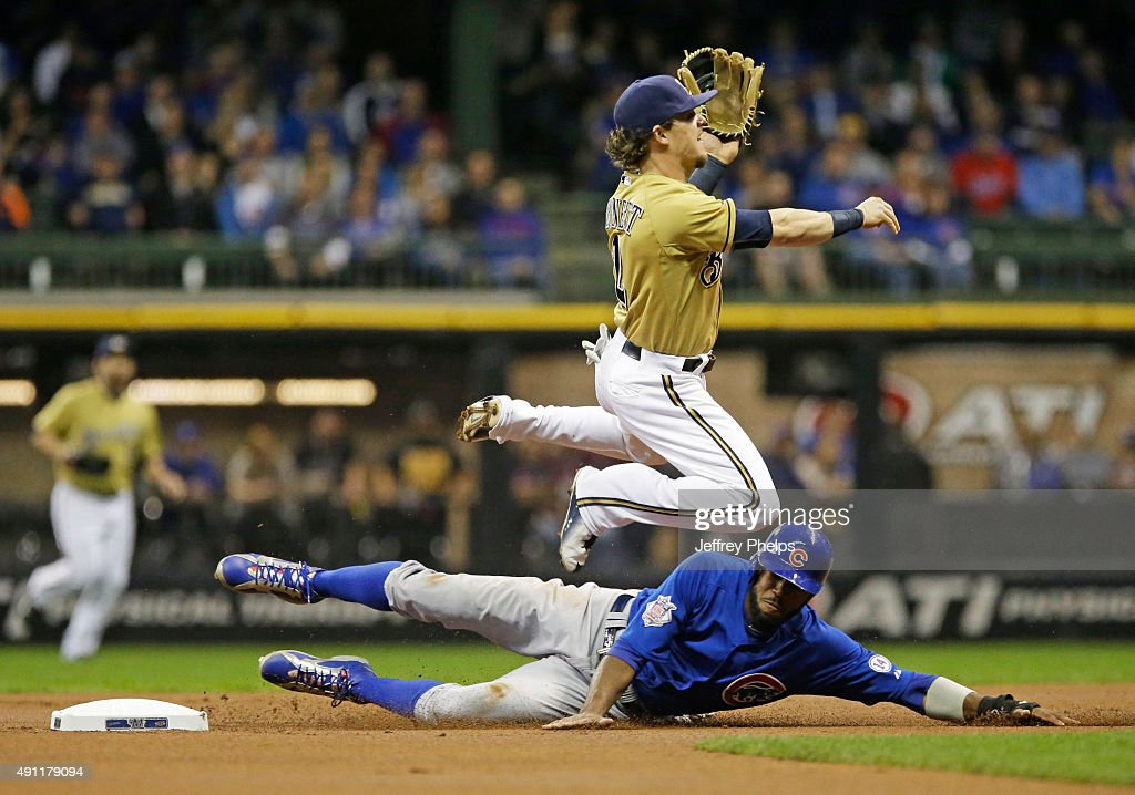 Scooter Gennett of the Milwaukee Brewers forces out Dexter Fowler of the Chicago Cubs at second base in the first inning of a baseball game at Miller...