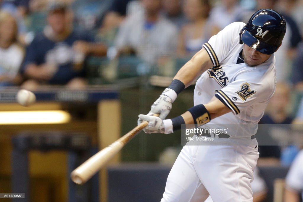 Scooter Gennett of the Milwaukee Brewers hits a double during the first inning against the Colorado Rockies at Miller Park on August 23 2016 in...