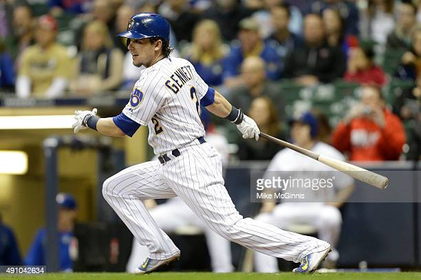 Scooter Gennett of the Milwaukee Brewers hits a single in the first inning against the Chicago Cubs at Miller Park on October 02 2015 in Milwaukee...