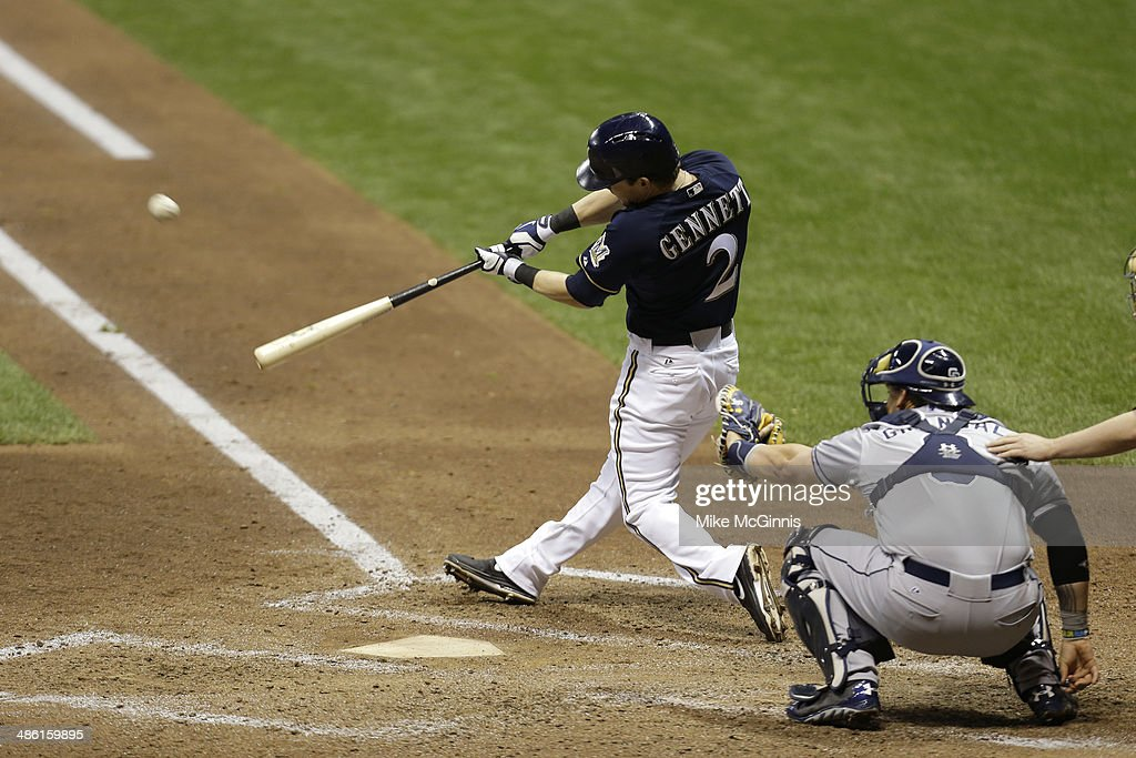 <a gi-track='captionPersonalityLinkClicked' href=/galleries/search?phrase=Scooter+Gennett&family=editorial&specificpeople=5502894 ng-click='$event.stopPropagation()'>Scooter Gennett</a> #2 of the Milwaukee Brewers hits a solo home run in the bottom of the fifth inning against the San Diego Padres at Miller Park on April 22, 2014 in Milwaukee, Wisconsin.
