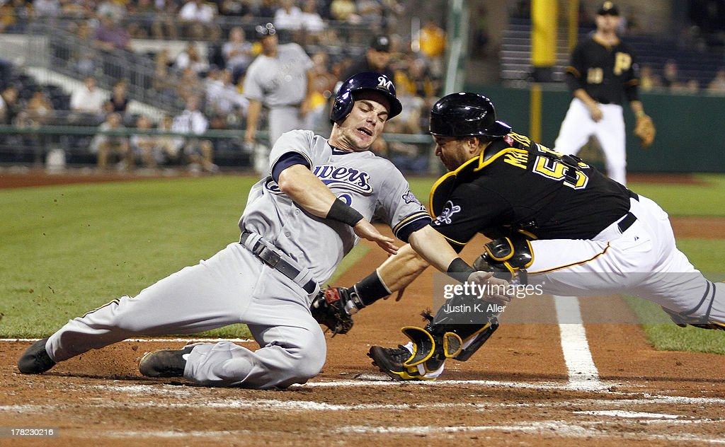 <a gi-track='captionPersonalityLinkClicked' href=/galleries/search?phrase=Scooter+Gennett&family=editorial&specificpeople=5502894 ng-click='$event.stopPropagation()'>Scooter Gennett</a> #2 of the Milwaukee Brewers is called safe in the fifth inning against <a gi-track='captionPersonalityLinkClicked' href=/galleries/search?phrase=Russell+Martin+-+Baseball+Player&family=editorial&specificpeople=13764024 ng-click='$event.stopPropagation()'>Russell Martin</a> #55 of the Pittsburgh Pirates during the game on August 27, 2013 at PNC Park in Pittsburgh, Pennsylvania.