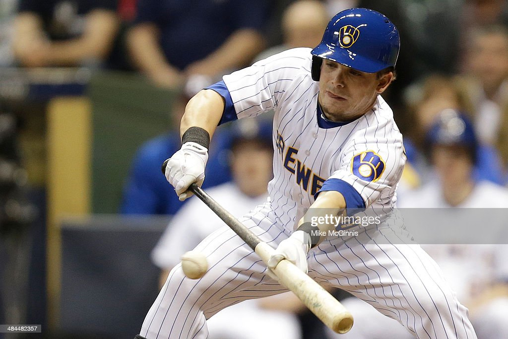 <a gi-track='captionPersonalityLinkClicked' href=/galleries/search?phrase=Scooter+Gennett&family=editorial&specificpeople=5502894 ng-click='$event.stopPropagation()'>Scooter Gennett</a> #2 of the Milwaukee Brewers lays down a sacrifice bunt in the bottom of the seventh inning advancing Khris davis to third base against the Pittsburgh Pirates at Miller Park on April 12, 2014 in Milwaukee, Wisconsin.