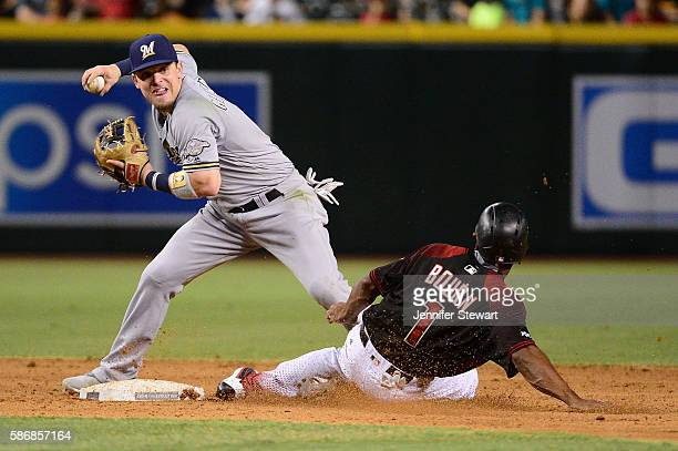 Scooter Gennett of the Milwaukee Brewers makes the force out on Michael Bourn of the Arizona Diamondbacks during the sixth inning at Chase Field on...