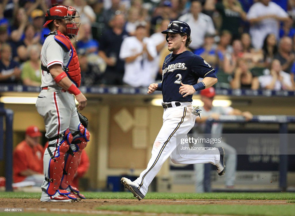 <a gi-track='captionPersonalityLinkClicked' href=/galleries/search?phrase=Scooter+Gennett&family=editorial&specificpeople=5502894 ng-click='$event.stopPropagation()'>Scooter Gennett</a> #2 of the Milwaukee Brewers scores as catcher <a gi-track='captionPersonalityLinkClicked' href=/galleries/search?phrase=Carlos+Ruiz+-+Baseball+Player&family=editorial&specificpeople=216605 ng-click='$event.stopPropagation()'>Carlos Ruiz</a> #51 of the Philadelphia Phillies waits at the plate during the seventh inning of their game at Miller Field on August 15, 2015 in Milwaukee, Wisconsin. The Brewers defeated the Phillies 4-2.
