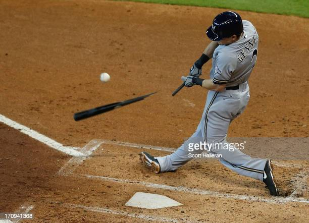 Scooter Gennett of the Milwaukee Brewers swings at a pitch in the second inning during the game against the Houston Astros at Minute Maid Park on...