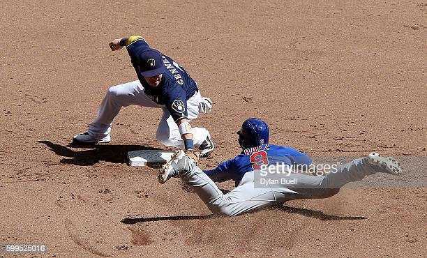 Scooter Gennett of the Milwaukee Brewers tags out Javier Baez of the Chicago Cubs during a tag up attempt in the fifth inning at Miller Park on...