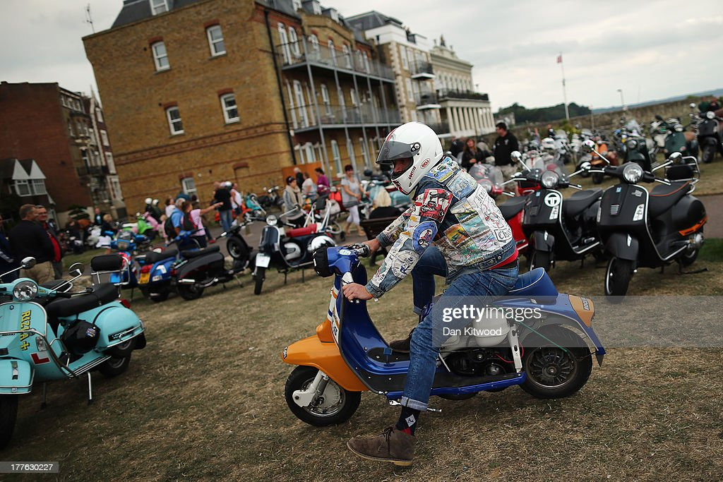 A scooter is driven along the sea front during the the Isle of Wight International Scooter Rally on August 24, 2013 in Ryde, England. The annual event, which is organized by the British Scooter Rally Association and The VFM Scooter Collective, attracts around 6000 riders each year and has been running since 1980. The scooter in 1960's Britain was a fashion statement and the often heavily customized bikes, usually an Italian Vespa or Lambretta, became synonymous with the Mod scene. They provided an inexpensive mode of transport and escapism to an upwardly mobile youth at a time when public transportation stopped early. The Vespa was depicted on the cover of 'The Who's Quadrophenia album in 1973.