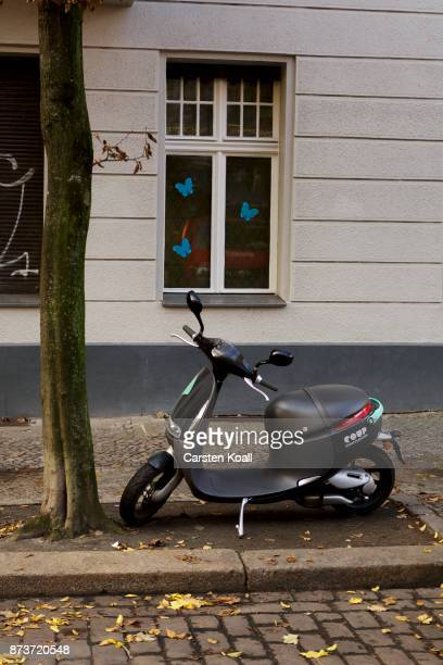 A scooter of the sharing agency Coup is parked on a street on November 13 2017 in Berlin Germany A number of companies have plunged into the market...