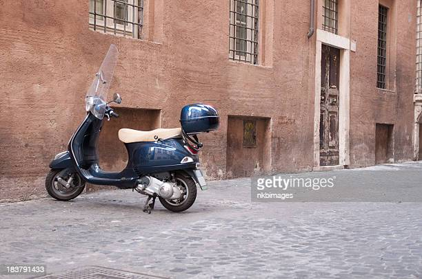 Scooter parked on road in Rome