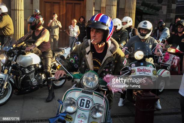 Scooter riders and members of motorcycle clubs arrive at St Ann's Square to pay their respects to the victims of who died in Monday's terror attack...