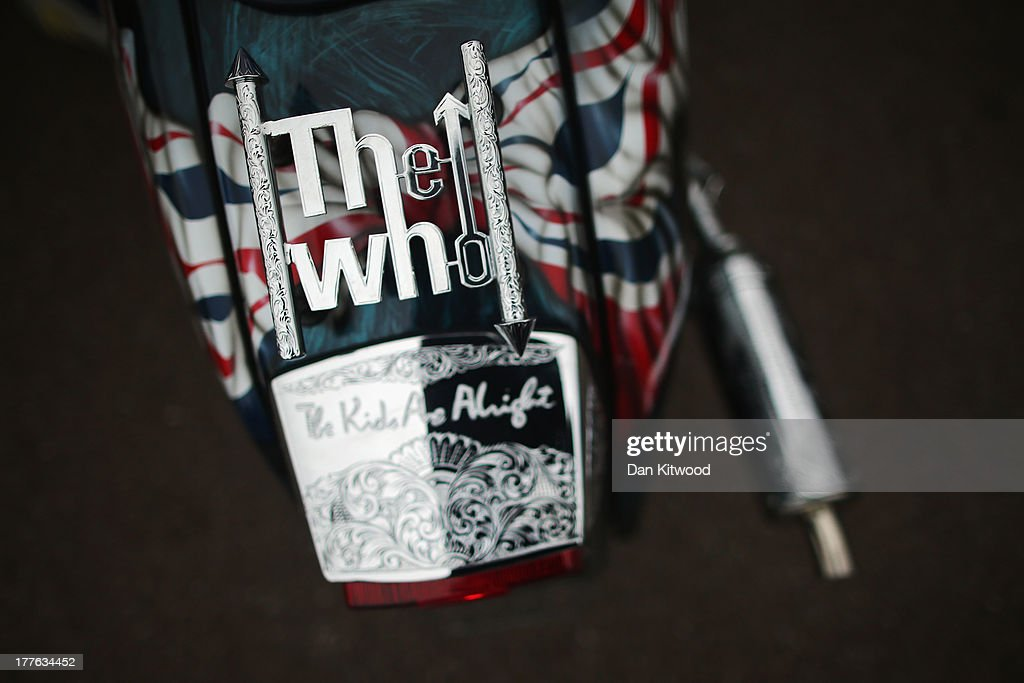 A scooter with a 'The Who' motif takes part in the 'Ride Out' during the annual Isle of Wight Scooter Festival on August 25, 2013 in Ryde, England. The annual event, which is organized by the British Scooter Rally Association and The VFM Scooter Collective, attracts around 6000 riders each year and has been running since 1980. The scooter in 1960s Britain was a fashion statement and the often heavily customized bikes, usually an Italian Vespa or Lambretta, became synonymous with the Mod scene. They provided an inexpensive mode of transport and escapism to an upwardly mobile youth at a time when public transportation stopped early. The Vespa was depicted on the cover of The Whos Quadrophenia album in 1973.