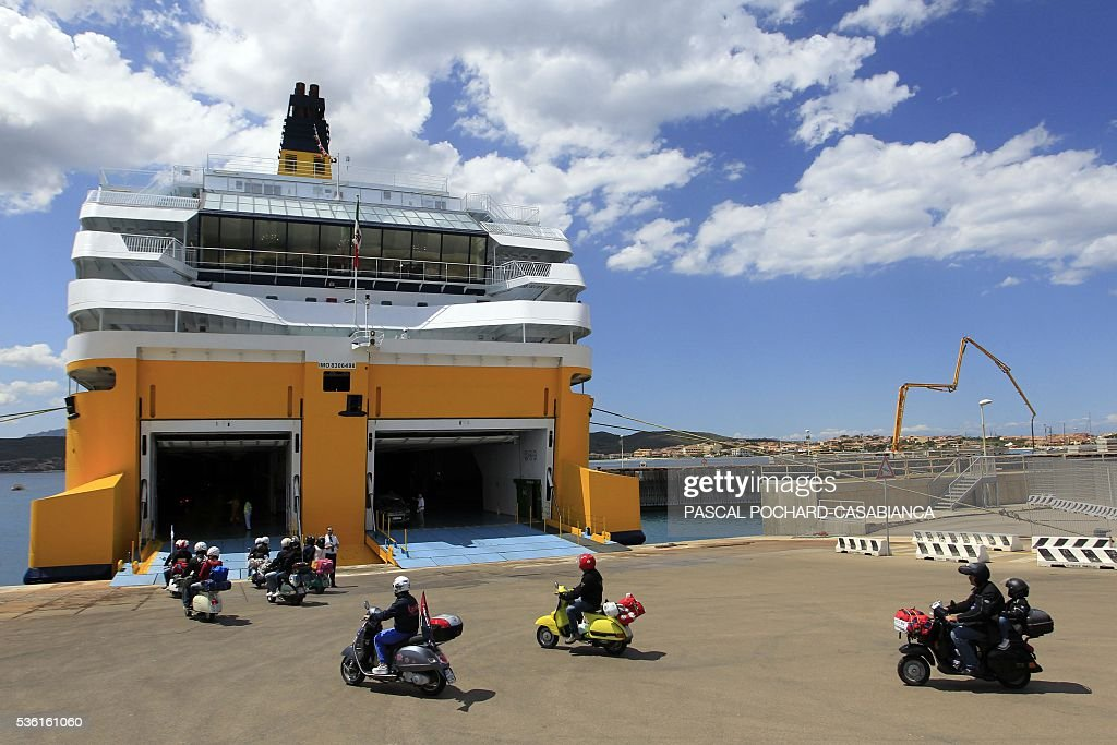 Scooters get in the new ferry boat Mega Andrea of the French Corsica Ferries company, on May 31, 2016 in Golfo Aranci on the Italian Mediterranean island of Sardegna. The Corsica Ferries opened, on May 31, a new line between Nice, Corsica and the island of Sardegna in Italy, reinforcing its position as a leader for the maritime transport between the two neighbour islands Corsica and Sardegna. / AFP / PASCAL