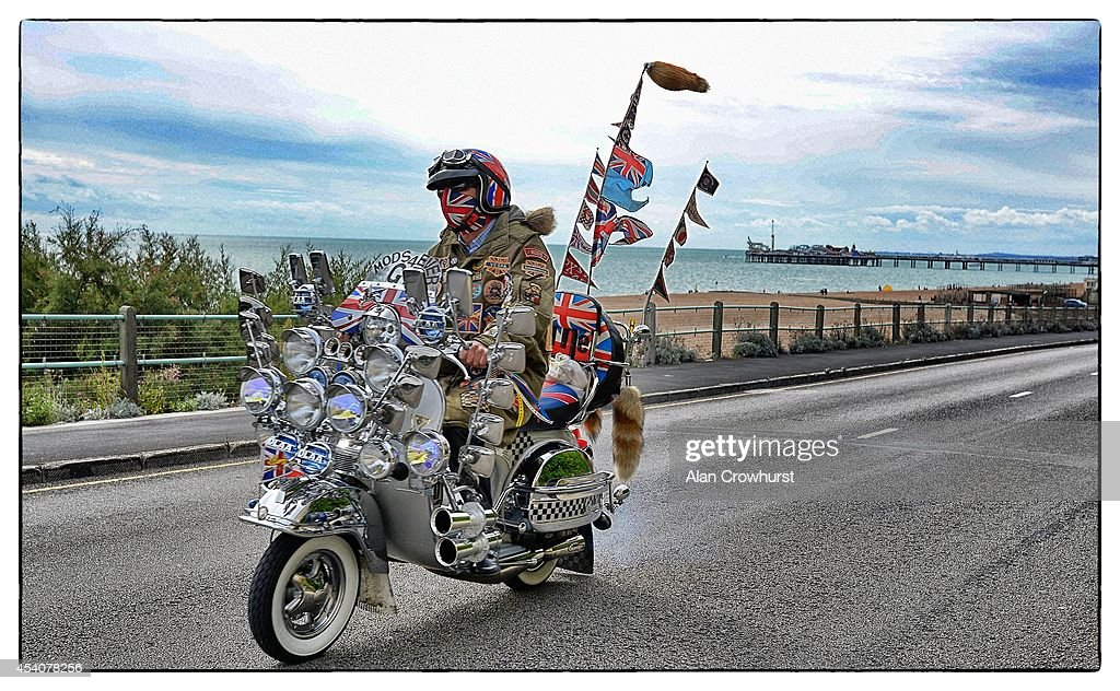 Scooters leave the seafront on a run out to Beachy Head during the Brighton Mod weekender on August 24, 2014 in Brighton, England. This August Bank holiday will see many Mods and their scooters return to their spiritual home of Brighton for the Mod Weekender event.