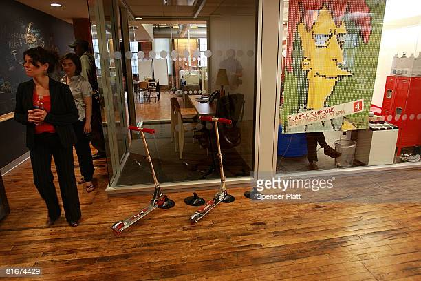 Scooters sit in a hallway for use by employees for Google at the internet company's new office space inside historic Chelsea Market June 23 2008 in...