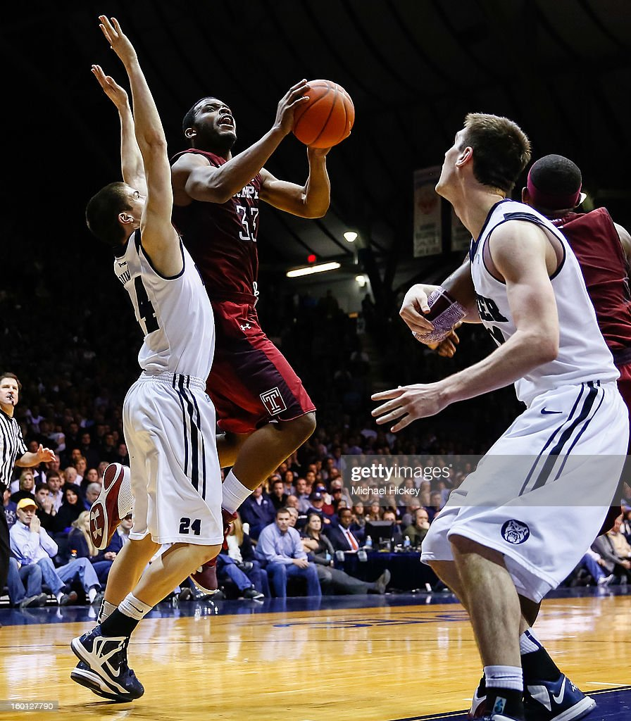 Scootie Randall #33 of the Temple Owls goes up for a shot as Kellen Dunham #24 of the Butler Bulldogs and <a gi-track='captionPersonalityLinkClicked' href=/galleries/search?phrase=Andrew+Smith+-+Basketball+Player&family=editorial&specificpeople=7641849 ng-click='$event.stopPropagation()'>Andrew Smith</a> #44 of the Butler Bulldogs defend at Hinkle Fieldhouse on January 26, 2013 in Indianapolis, Indiana. Butler defeated Temple 83-71.
