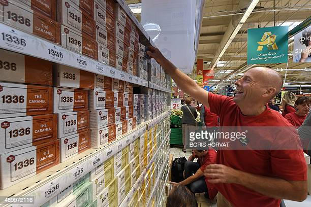 A ScopTi employee puts on display the new tea '1336' on sale from today in a supermarket in Aubagne on September 25 2015 The '1336' tea is produced...