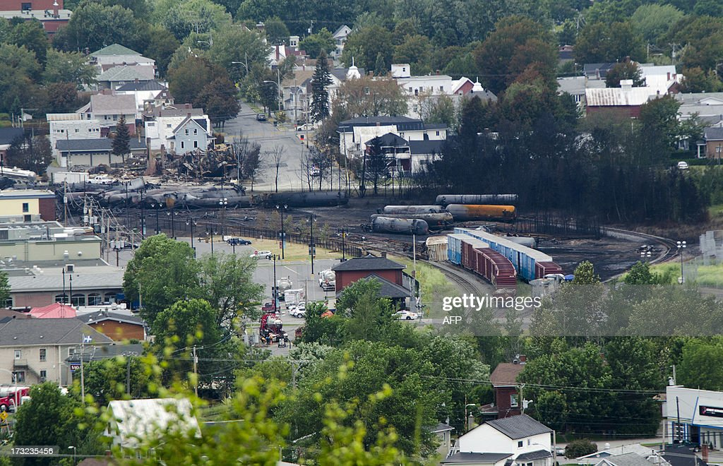 Scorched oil tankers remain on July 10 2013 at the train derailment site in LacMegantic Quebec Edward Bukhardt CEO of Montreal Maine and Atlantic...