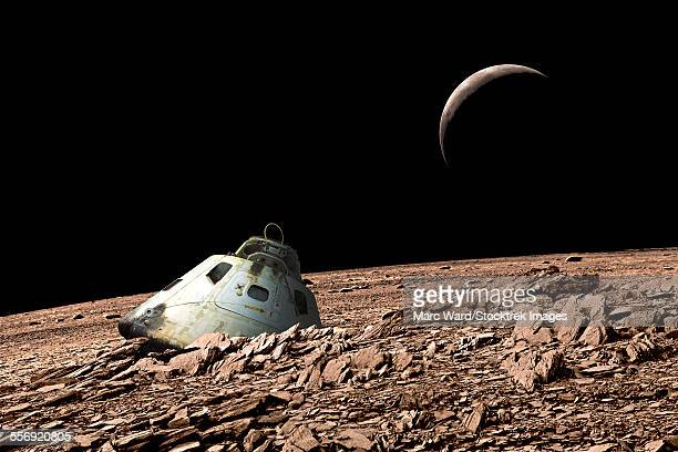 A scorched space capsule lies abandoned on a barren and airless moon.