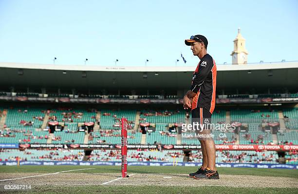 Scorchers coach Justin Langer looks at the pitch before the Big Bash League match between the Sydney Sixers and Perth Scorchers at Sydney Cricket...