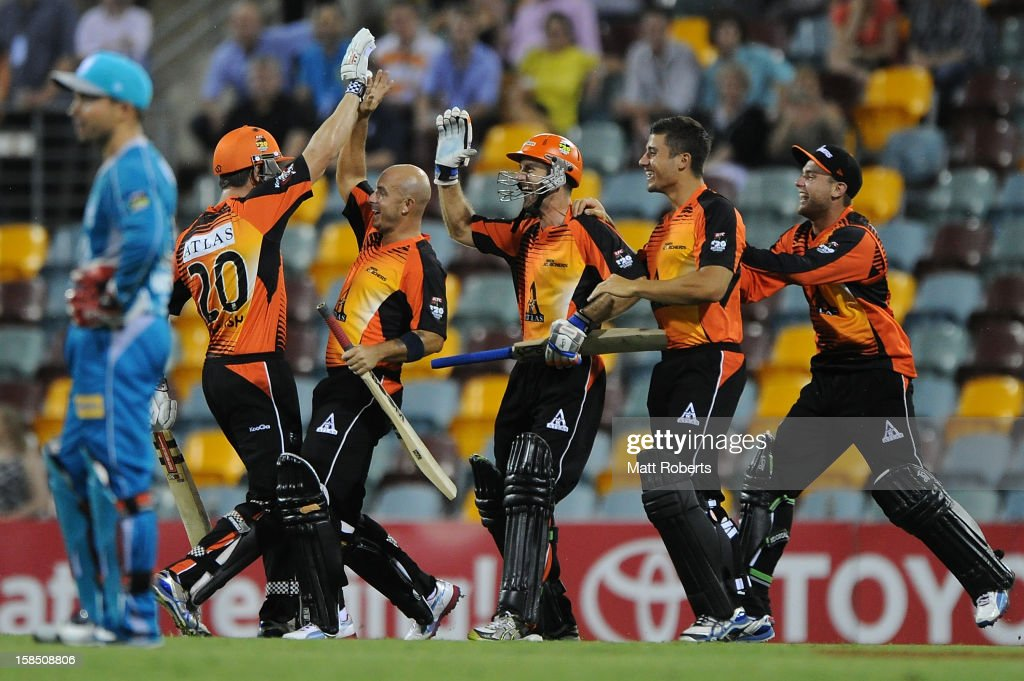 Scorchers players celebarte victory after the Big Bash League match between the Brisbane Heat and the Perth Scorchers at The Gabba on December 18, 2012 in Brisbane, Australia.